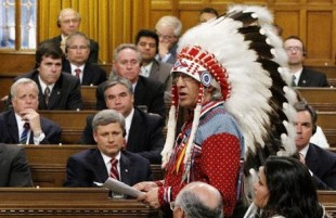 National Chief of  the Assembly of First Nations Phil Fontaine speaks in the House of Commons on Parliament Hill in Ottawa