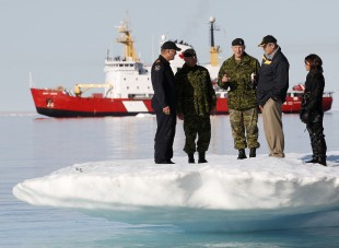 Joustra - Defence Spending Harper talks with Natynczyk while standing on an iceberg in Allen Bay in Resolute