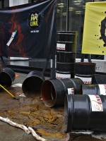 Greenpeace protestors begin the cleanup of a simulated oil spill outside the Enbridge oil pipeline offices in Vancouver