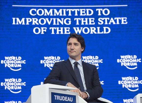 Canada's Prime Minister Justin Trudeau listens to his introduction as he addresses the World Economic Forum in Davos, Switzerland on Wednesday, Jan. 20, 2016. Trudeau is attending the event where political, business and social leaders are gathered to discuss world agendas. (Andrew Vaughan /The Canadian Press via AP) MANDATORY CREDIT