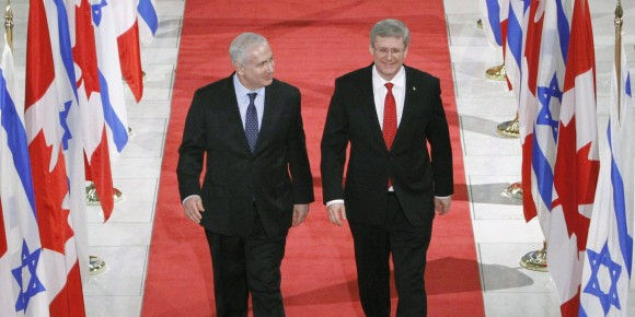 Prime Minister of Israel Benjamin Netanyahu walks with Canadian Prime Minister Stephen Harper (right) prior to holding a joint news conference in Ottawa Friday, March 2, 2012.