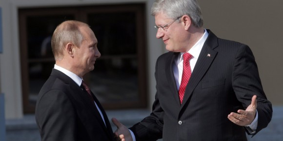 Russia's President Vladimir Putin, left, speaks with Canada's Prime Minister Stephen Harper during arrivals for the G-20 summit at the Konstantin Palace in St. Petersburg, Russia on Thursday, Sept. 5, 2013. The threat of missiles over the Mediterranean is weighing on world leaders meeting on the shores of the Baltic this week, and eclipsing economic battles that usually dominate when the G-20 world economies meet.