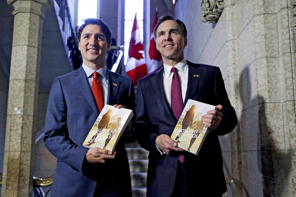 Prime Minister Justin Trudeau and Finance Minister Bill Morneau  pose with the 2016 federal budget.