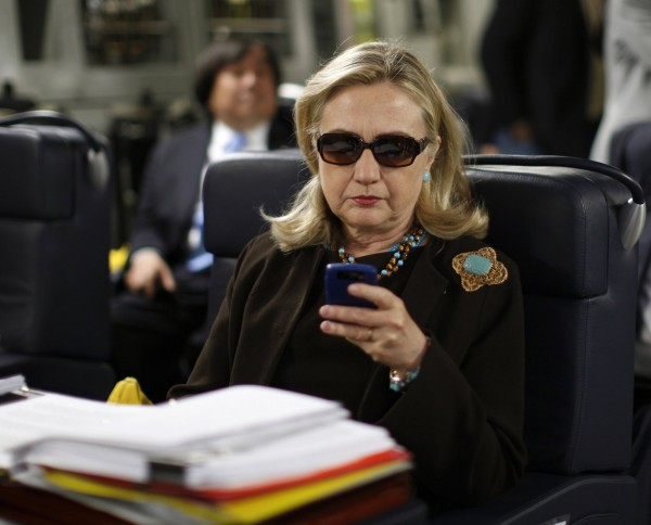 Hillary Rodham Clinton uses her BlackBerry in October 2011, while she was secretary of State. Kevin Lamarque / Associated Press