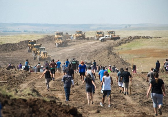 Native American protesters forced construction workers and security forces to retreat and work to stop on a North Dakota pipeline project in September 2016. Image: AFP/Getty Images