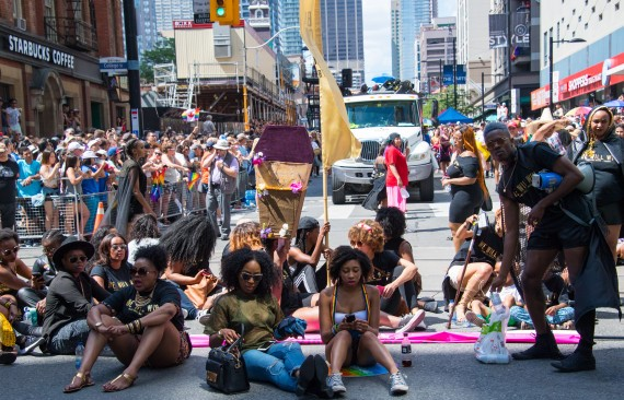 Members of Black Lives Matter sit and block Toronto's Pride Parade from the normal parade route. (Photo by Roberto Machado Noa/LightRocket via Getty Images)