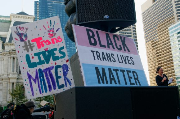 Philadelphia, PA, USA - October 10, 2015; Signs at Thomas Paine Plaza allude to transgender victims of violence, most of them trans women of color. Participants in the 5th annual Philly Trans* March gather in Center City, Philadelphia Pa, on Saturday October 10, 2015. The event was themed 'Rebuild the Unity in our Community' and is held in support of the transgender community. (Image: Bastiaan Slabbers)