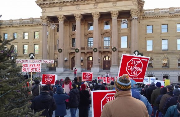 Protesters gather at the Alberta Legislature in Edmonton for an Anti-carbon rally on Saturday, November 5, 2016.