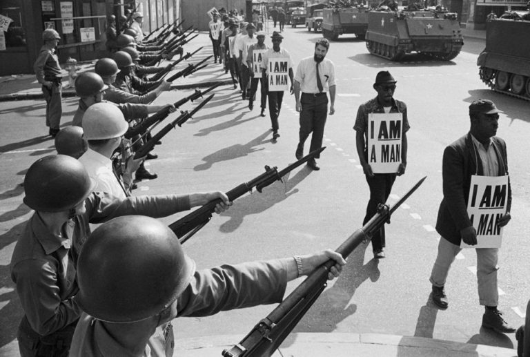Black and white photo of protest. What is the power of one's narrative in influencing how they approach their history?