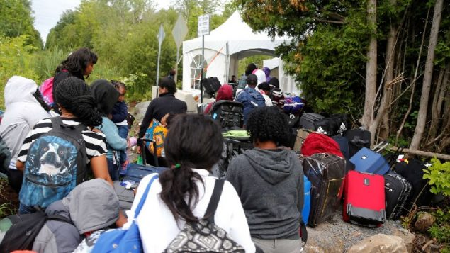 Asylum seekers looking to illegally cross from Champlain, N.Y., to Saint-Bernard-de-Lacolle, Quebec, using Roxham Road. We need to evaluate this through an open, rational debate on immigration policy in Canada.