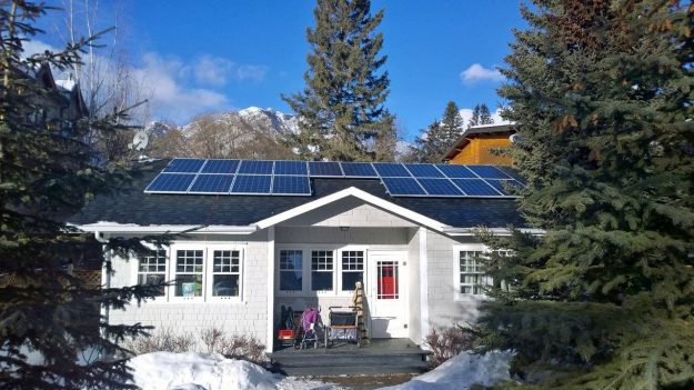 Canadian home with solar panels installed. is solar energy renewable? is solar energy cost-effective?