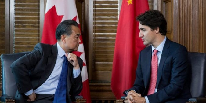 Justin Trudeau is pictured in talks with Chinese Foreign Affairs Minister Wang Yi. To date Justin Trudeau has resisted releasing Meng in an attempt to deescalate the Canada-China relationship.