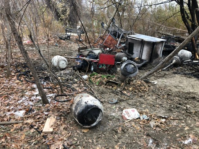 Abandoned, burned out propane tanks pictured in Vancouver homeless camp