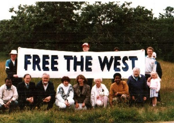 Western Canada Concept founder Doug Christie speaks at a rally in 1980 with Free the West movement members showing support.
