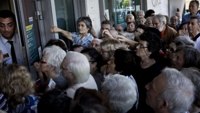 Lineups outside ATMs in Greece when governments closed banks during their financial crisis.