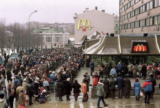Picture of lineup outside McDonalds. A result of the control of liberty enforced by command economies.