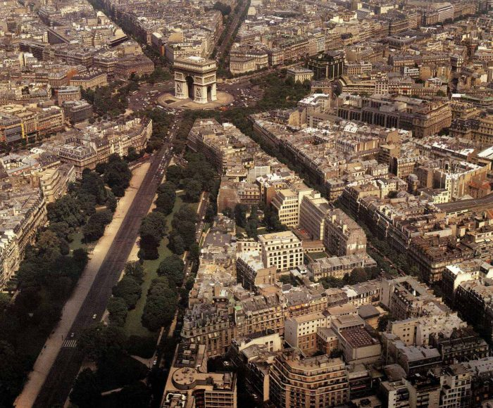 Aerial shot of Paris streets showing the mix of architectural styles in the modern world.