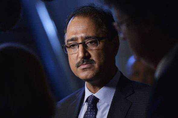 Minister of Natural Resources Amarjeet Sohi speaks to reporters in Calgary in 2018.