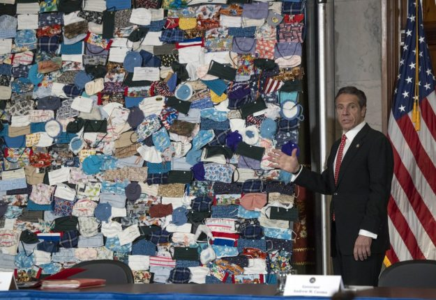 Pictured is NY Governor Mark Cuomo's unveilling of a collage of masks. A stunt working to sell the narrative of the COVID-19 pandemic.