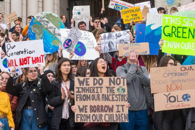 Climate protesters use compelling narratives on their signs to further their views and grow their following.