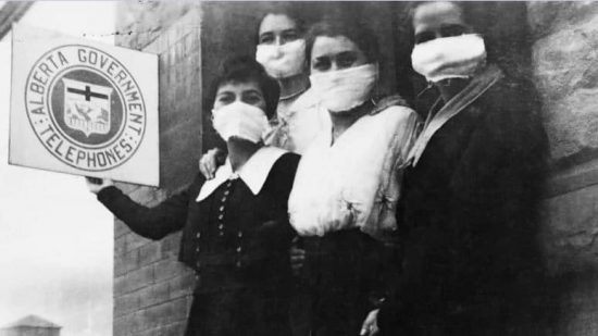 Picture of individuals wearing medical masks during Spanish Flu. A now common sighting as politicians ease lockdown restrictions.