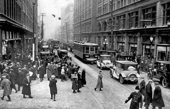 Busy street in 1920s. Difficult to imagine exactly how the economy will recover from the lockdown