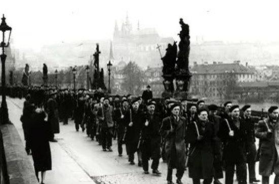 A grim reminder: Mikulasz Dzurina remembers the reality of Communism. Image below of The People's Militia's 1948 seizure of power in Czechoslovakia which marked four decades of authoritarian rule.